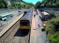 Soon to be historic rolling stock: a down 143 heads for Cardiff as an up 142 heads for Merthyr (Valleys convention) at the loop at Merthyr Vale on 30th June 2019. The former colliery was to the right, and behind the photographer.<br><br>[Ken Strachan 30/06/2018]