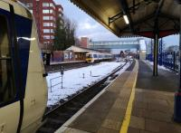 Up (right) and down (left) trains crossing at High Wycombe on a snowy and slippery February Saturday.<br><br>[Ken Strachan 02/02/2019]