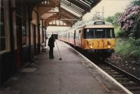 Dynamism at Pollokshields West. Stationmaster takes a break from clearing the platform.<br><br>[Ewan Crawford //]