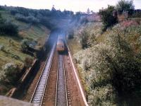 A DMU bursts smokely out of Cowlairs tunnel. The line here was crossed by a freight branch of the Caley now closed and removed.<br><br>[Ewan Crawford //1987]