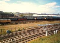 Turkey Yard looking west. Top to bottom; E&G (out of sight), Cowlairs Carriage Depot, Turkey Yard, Sighthill Branch, CGU.<br><br>[Ewan Crawford //1987]