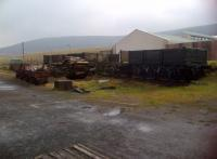 Here is a picture oozing with atmosphere, from the sleeper crossing in the foreground and the foundations of a demolished hut to the pit props waiting to be used underground. The dark horizontal line across the hills in the background is also historic. According to local legend, a large excavator had been shipped to Blaenavon in parts and built on site to do a job. Its next job was just a few miles South, so they used it to dig its own road along the hillside. This took place shortly after WW2 - presumably, the word remediation had not yet entered the dictionary.<br><br>[Ken Strachan 20/04/2014]