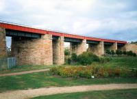 This mammoth viaduct carried the line from Whifflet to Airdrie CR. By the time of the photograph it only carried the line to BSC Imperial works. Today it is a cyclepath.<br><br>[Ewan Crawford //1987]