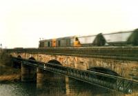 A pair of 20s crosses the Clydebridge viaduct heading west with a train of empty coal wagons.<br><br>[Ewan Crawford //1988]