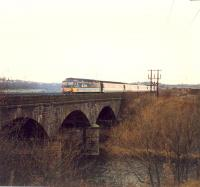 Diverted eastbound 477 crossing the Clydebridge Viaduct.<br><br>[Ewan Crawford //1988]