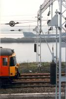 Eastbound 303 passes eastbound ship at Bowling Harbour. Nice tensioners on the catenary.<br><br>[Ewan Crawford //1990]
