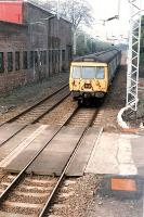 A 311 on an eastbound service approaches Bowling signalbox. Access by kind permission of British Rail.<br><br>[Ewan Crawford //1990]