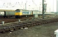 47 597 comes up from the Newcastle line with a Settle and Carlisle Line train. A great day if you liked 47s.<br><br>[Ewan Crawford 26/11/1988]