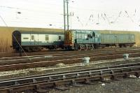 An 08 shunting Motorail coaches on a day of class 47s monotony at Carlisle. Exotic.<br><br>[Ewan Crawford 26/11/1988]