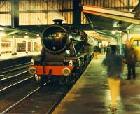 How unusual, a steam engine off the S&C at Carlisle! 48151 draws little attention as it grows dark.<br><br>[Ewan Crawford 26/11/1988]