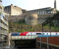 Trains held on New Street bridge on the eastern approach to Waverley on Sunday morning 30 April 2006. Under construction on the left is the new Edinburgh Council HQ, part of the Waverley Valley development, while on the right is the top floor of the former New Street bus depot, currently undergoing demolition as part of the same project.<br><br>[John Furnevel 30/04/2006]