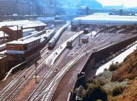 View over the east end of Waverley in October 1978, with a class 47 taking a train out of 'sub' platform 21 past the goods depot. The old Waverley East signal box is on the left with the corner of New Street bus depot opposite. The 1977 signalling Centre is in the left background beyond the train.<br><br>[John Furnevel 07/10/1978]