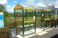 The new HITRANS shelter at Banavie station. New shelters such as these are being installed all over Scotland - the first investment in shelters for some time.<br><br>[Ewan Crawford 28/05/2006]